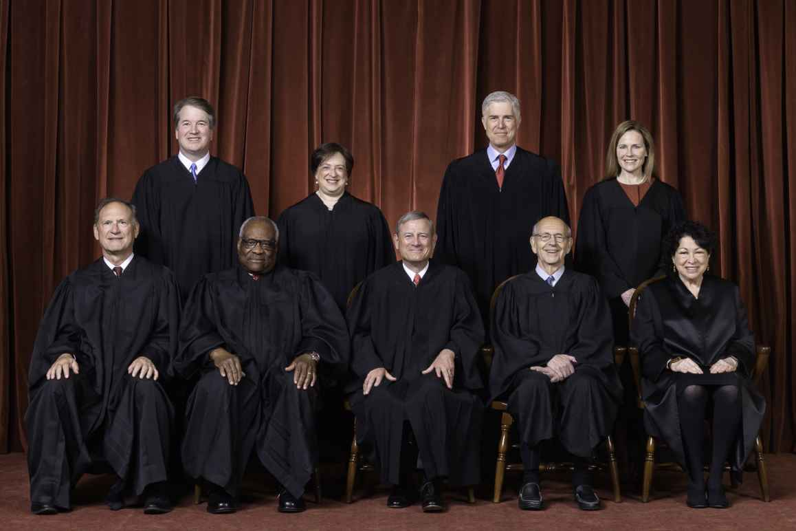 Photo of the Supreme Court Justices in black robes as composed October 27, 2020.