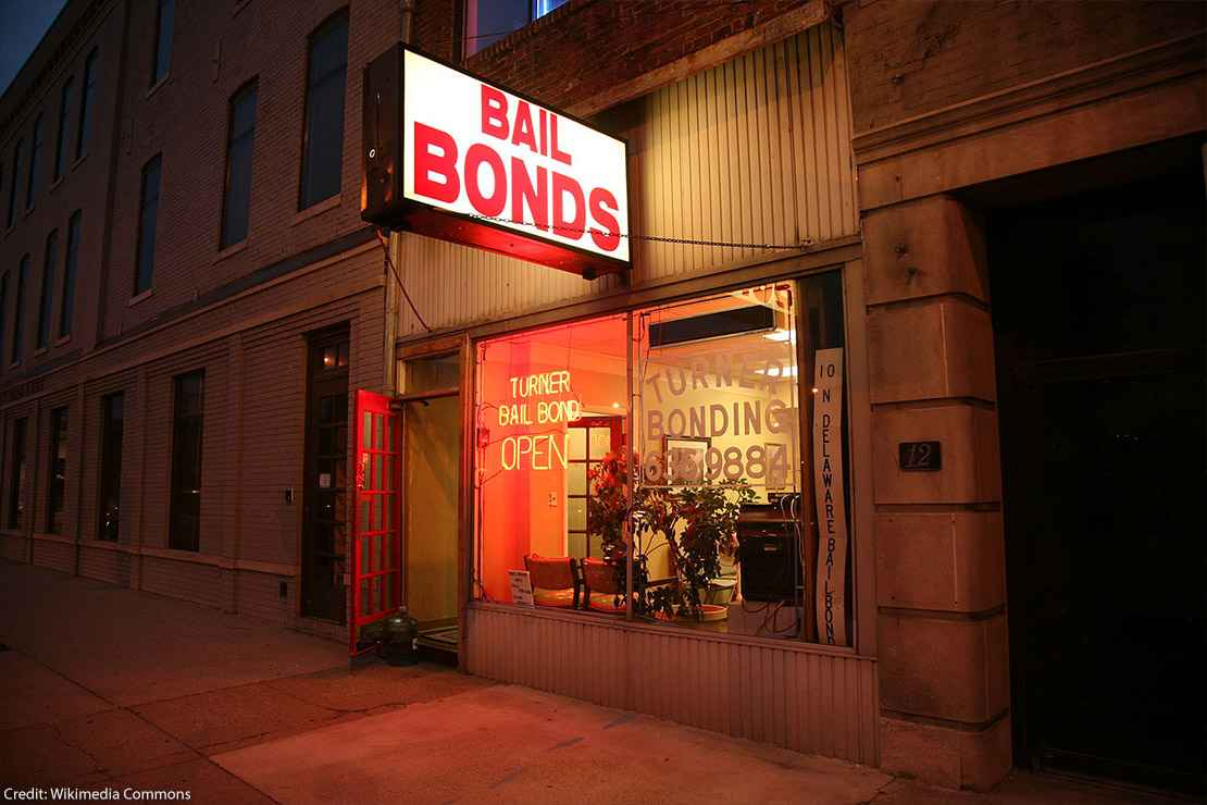 Photo of a bail bonds shop at night.