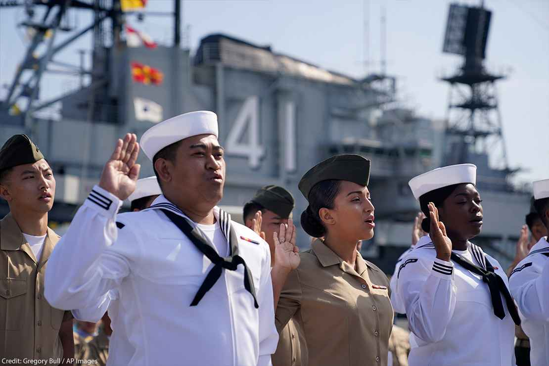 United States Navy sailors and Marines from ten different countries take an oath of citizenship during a ceremony for members of the military aboard the USS Midway Museum Friday, July 2, 2021, in San Diego.