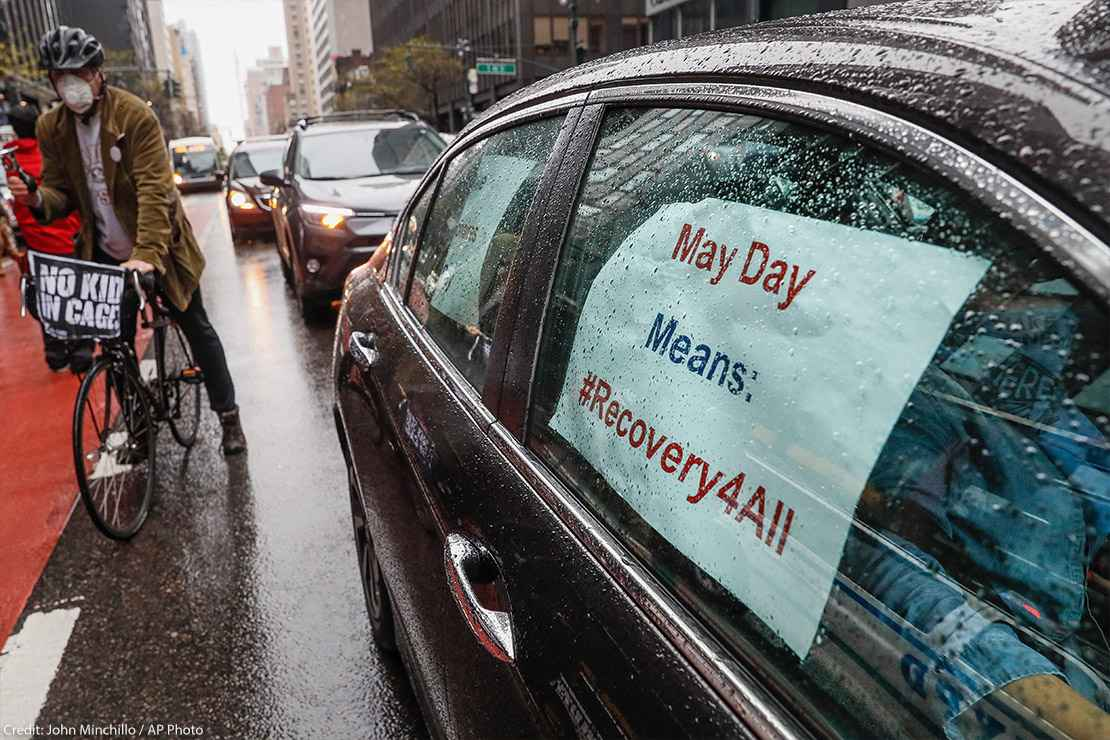 A caravan of May Day protestors drive up 2nd Avenue in New York City during COVID pandemic.