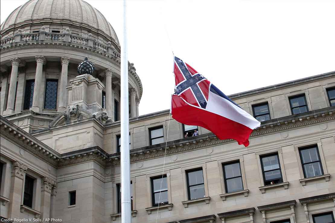 The retired Mississippi state flag is raised over the Capitol grounds one final time in Jackson, Mississippi