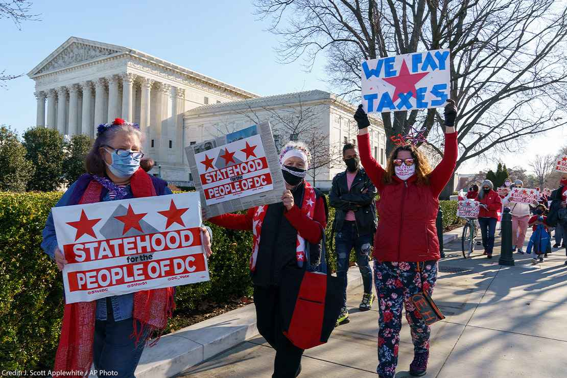 Advocates for statehood for the District of Columbia rally near the Supreme Court and Capitol prior to a House of Representatives hearing on creating a fifty-first state, in Washington, Monday, March 22, 2021.
