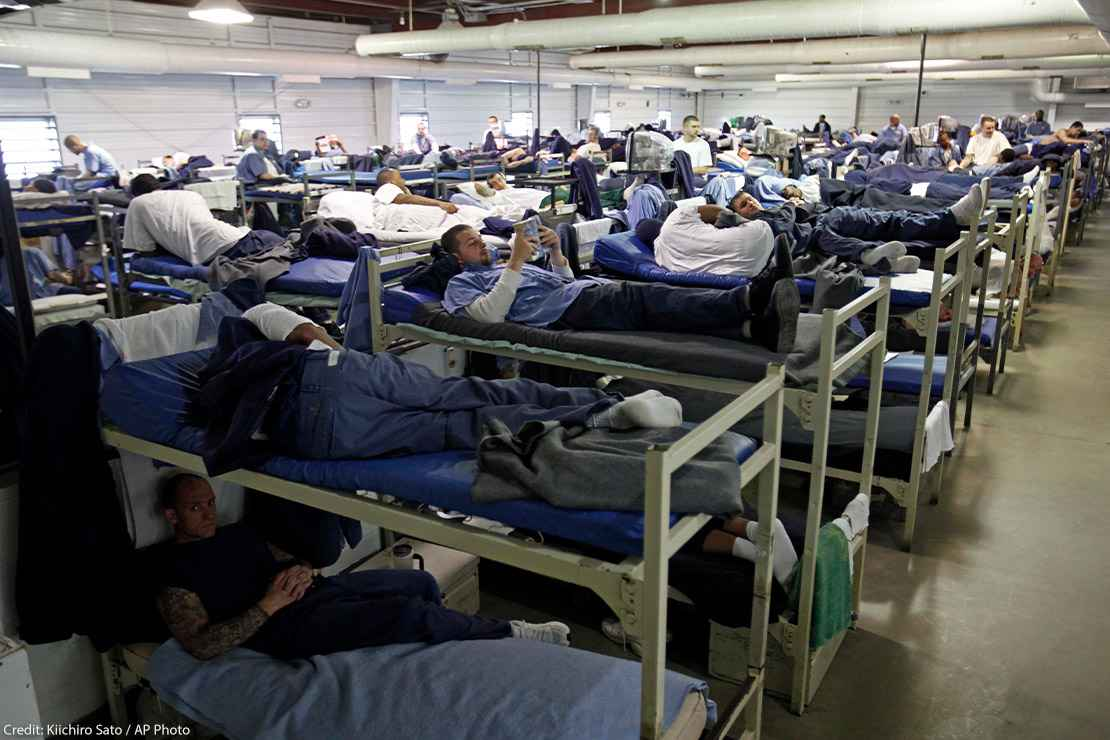 A room full of inmates are seen in their bunk beds