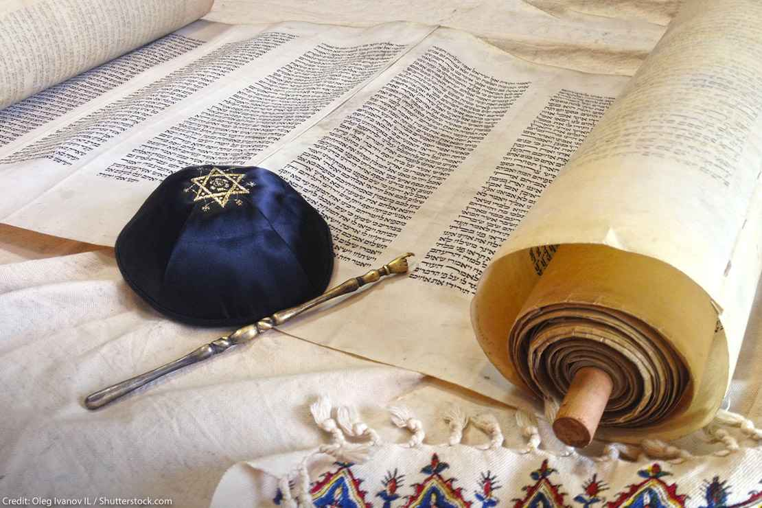 The Hebrew handwritten Torah, on a synagogue alter, with Kippah and Talith
