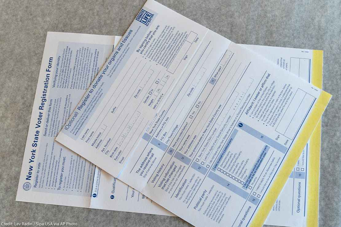 Photo from above of New York State Voter registration forms