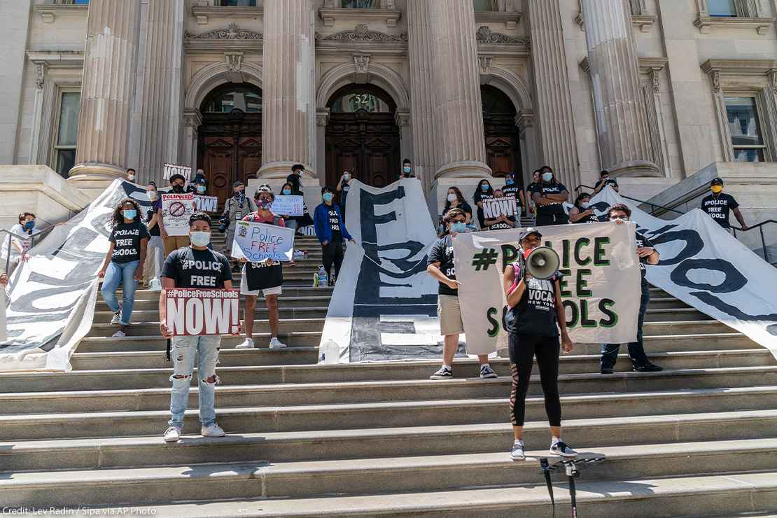 Protesters demanding removing police officers from schools on steps of Department of Education in Manhattan, New York.