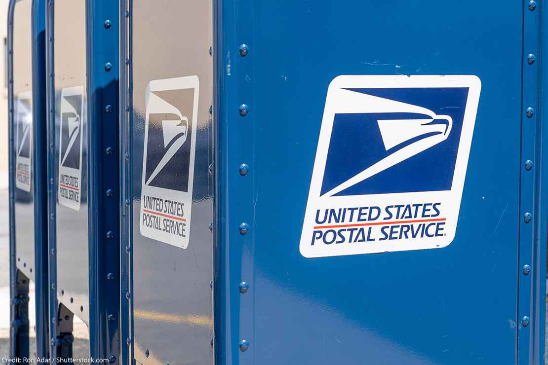 A blue United States Postal Service (USPS) collection box as seen on the street.