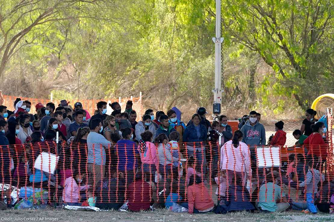 Migrants in custody at U.S. Customs and Border Protection processing area under the Anzalduas International Bridge, Friday, March 19, 2021, in Mission, Texas.