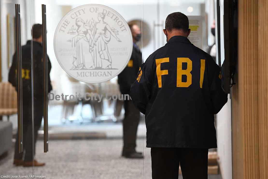 An FBI employee guards the entrance doors to the Detroit City Council on the 13th floor of the Coleman A. Young Municipal Center, Thursday, Aug. 25, 2021, in Detroit.