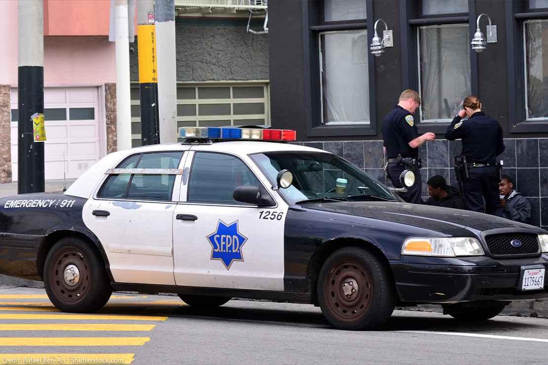 White SFPD officers interrogating Black men in San Francisco.