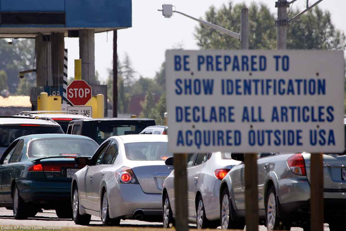 A line of cars wait to enter the United States from Canada in Blaine, Wash.