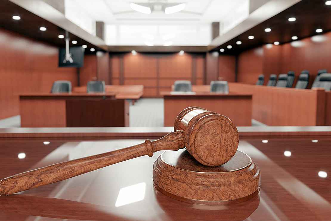 Image of a gavel in a courtroom