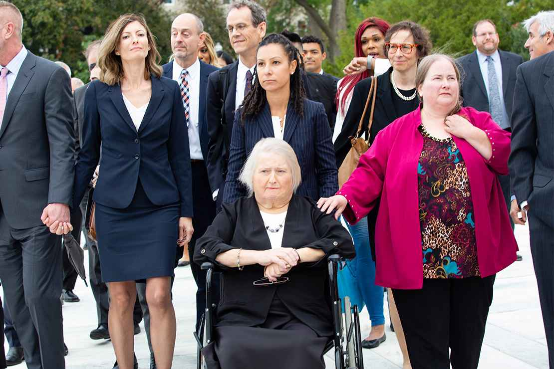 Aimee Stephens with her wife and legal team outside the Supreme Court.