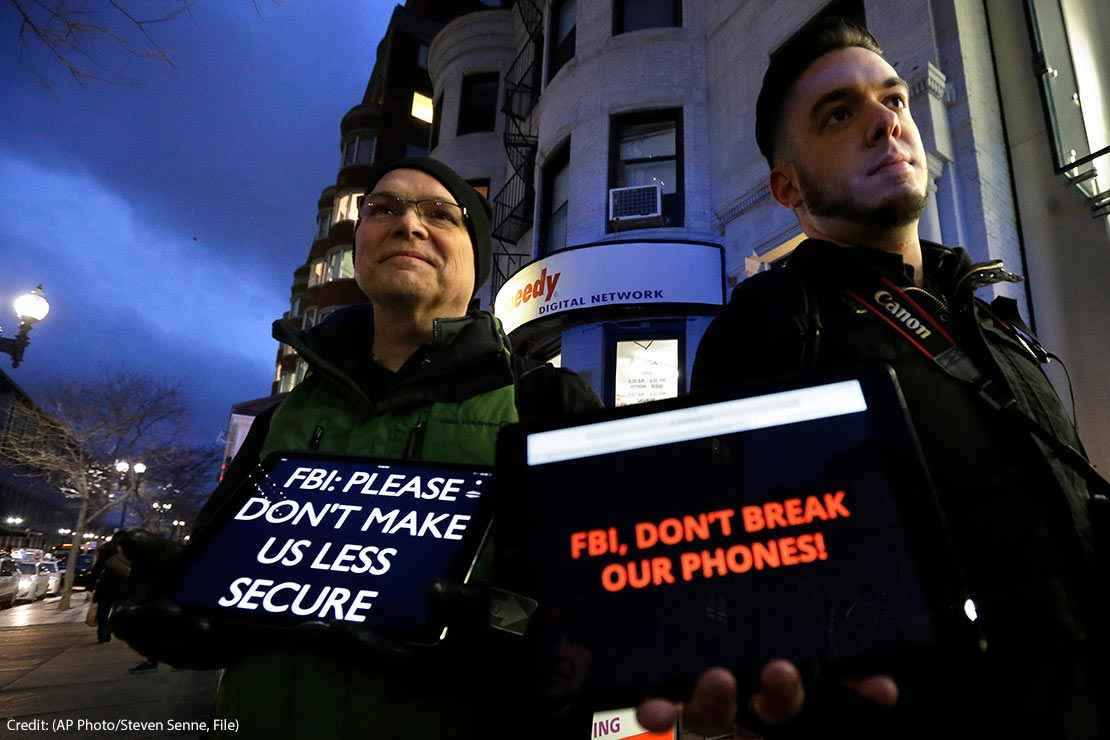 "Demonstrators display iPads with the messages ""FBI: Please don't make us less secure"" and ""FBI, don't break our phones!"""