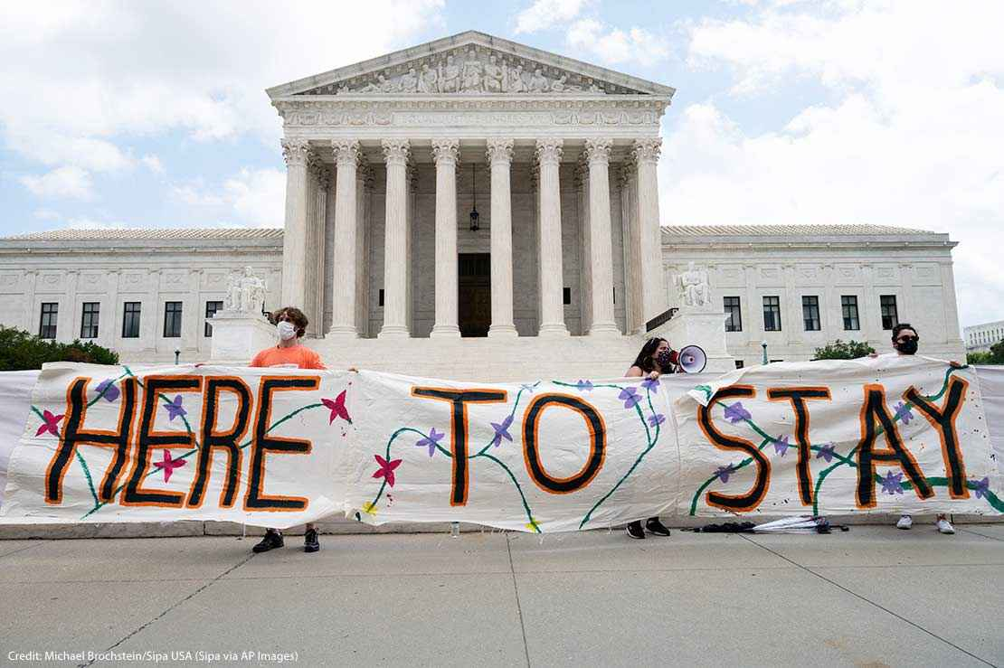 """""""Here to Stay"""" banner at a rally in favor of DACA (Deferred Action for Childhood Arrivals) is seen in front of the Supreme Court."""
