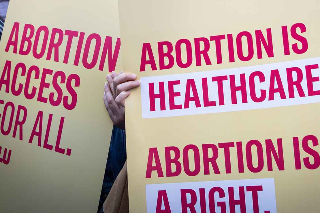 Protest signs advocating for abortion access.