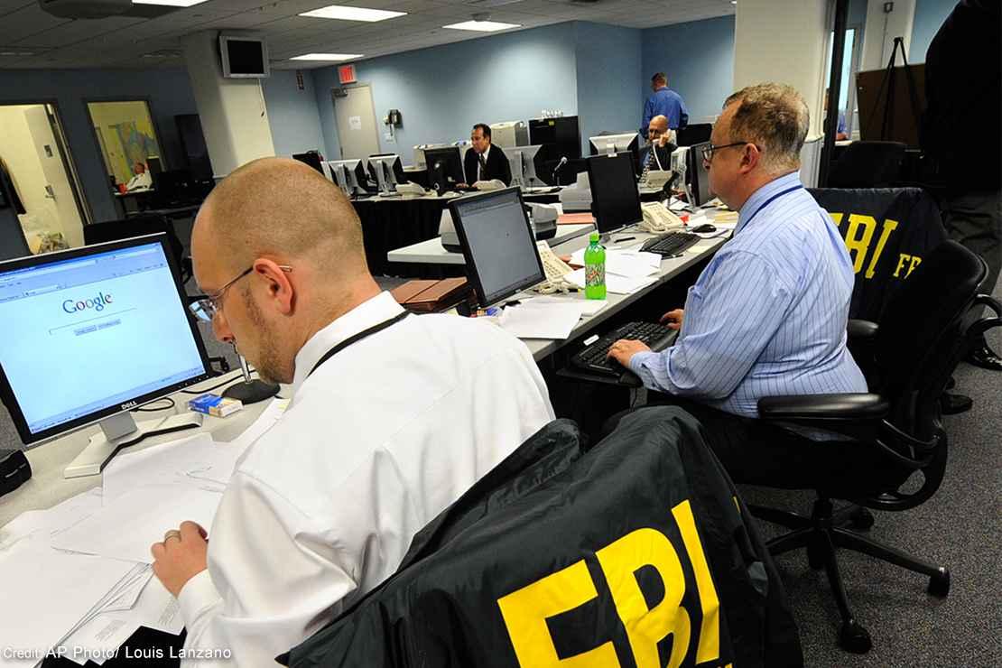 An FBI agent reads through documents.