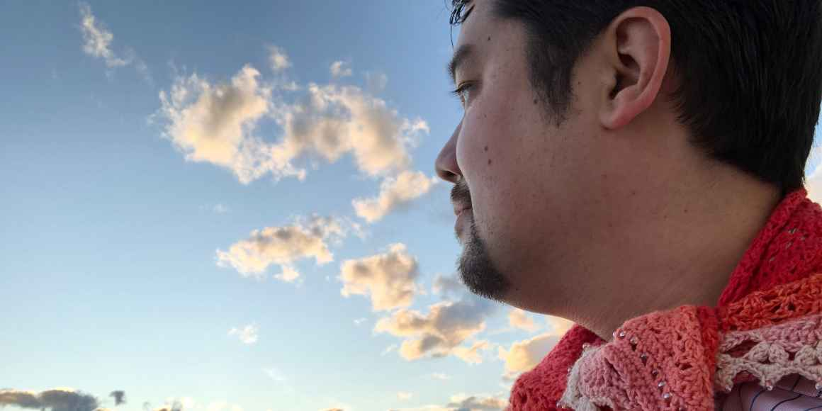 Shige Sakurai with the sky in the background.