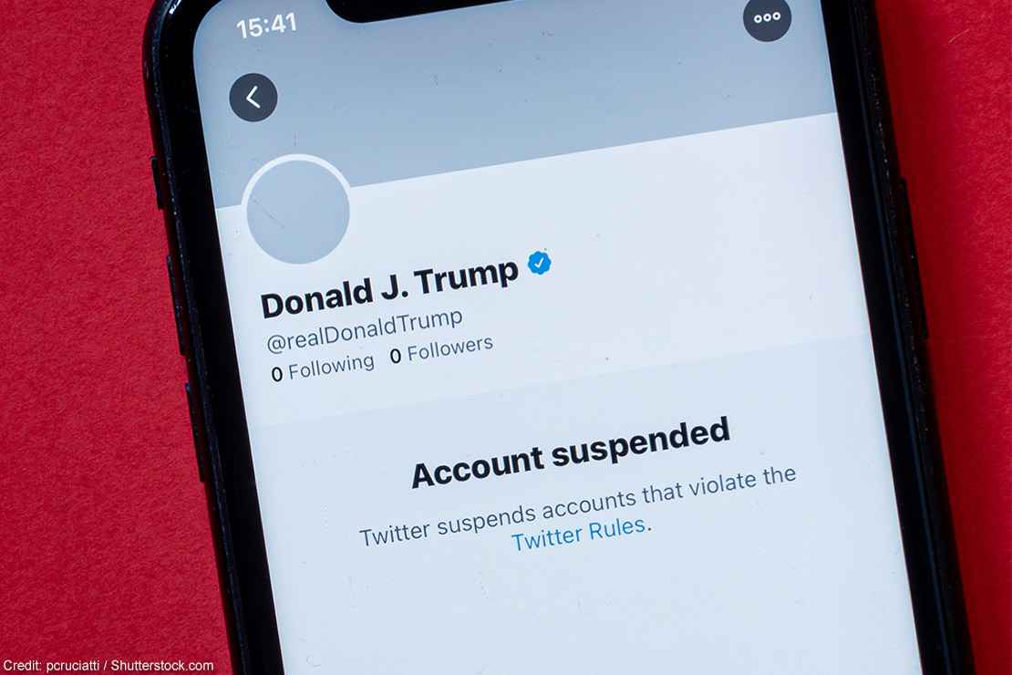 A smartphone showing Donald J. Trump's suspended Twitter account.