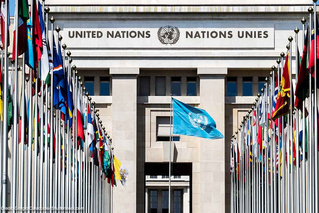 National flags at the entrance of the UN office in Geneva, Switzerland.