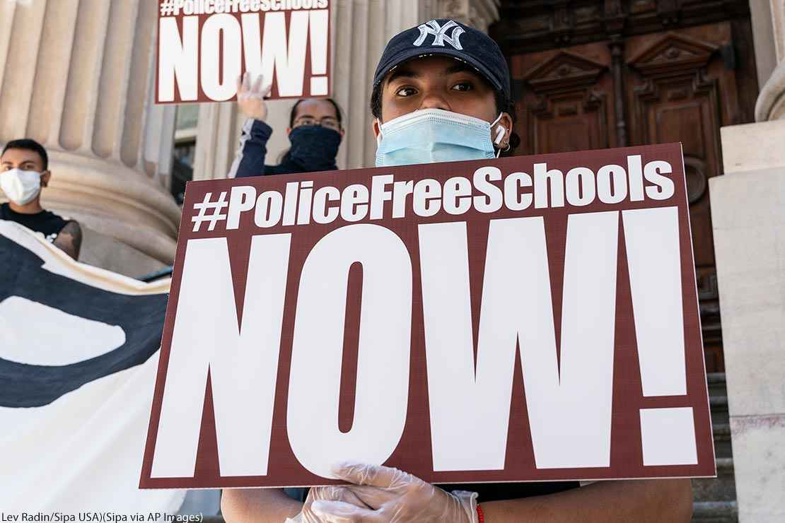 Protesters demanding removing police officers from schools on steps of Department of Education know as Tweed Courthouse in New York on June 25, 2020.