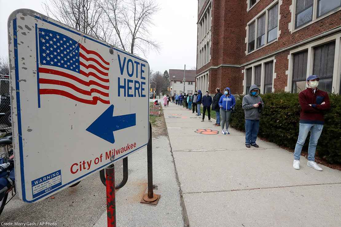 Voters line up outside of a polling station in Milwaukee for Wisconsin's primary election.