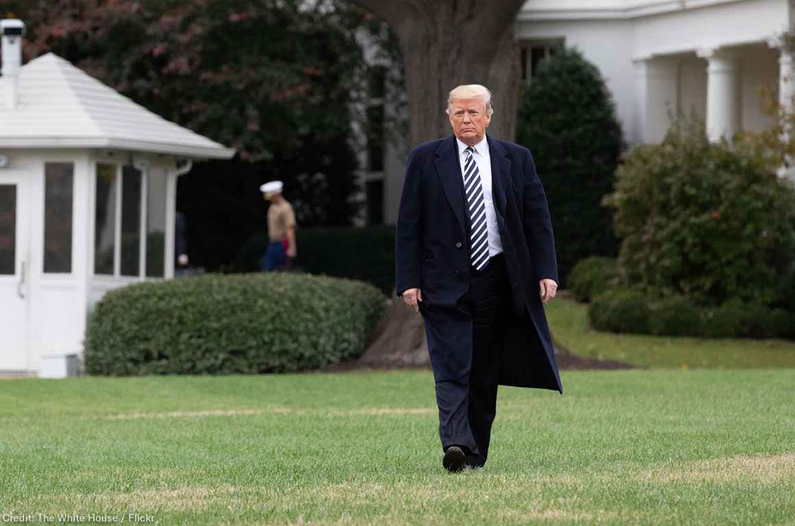 Trump walking on the White House Lawn