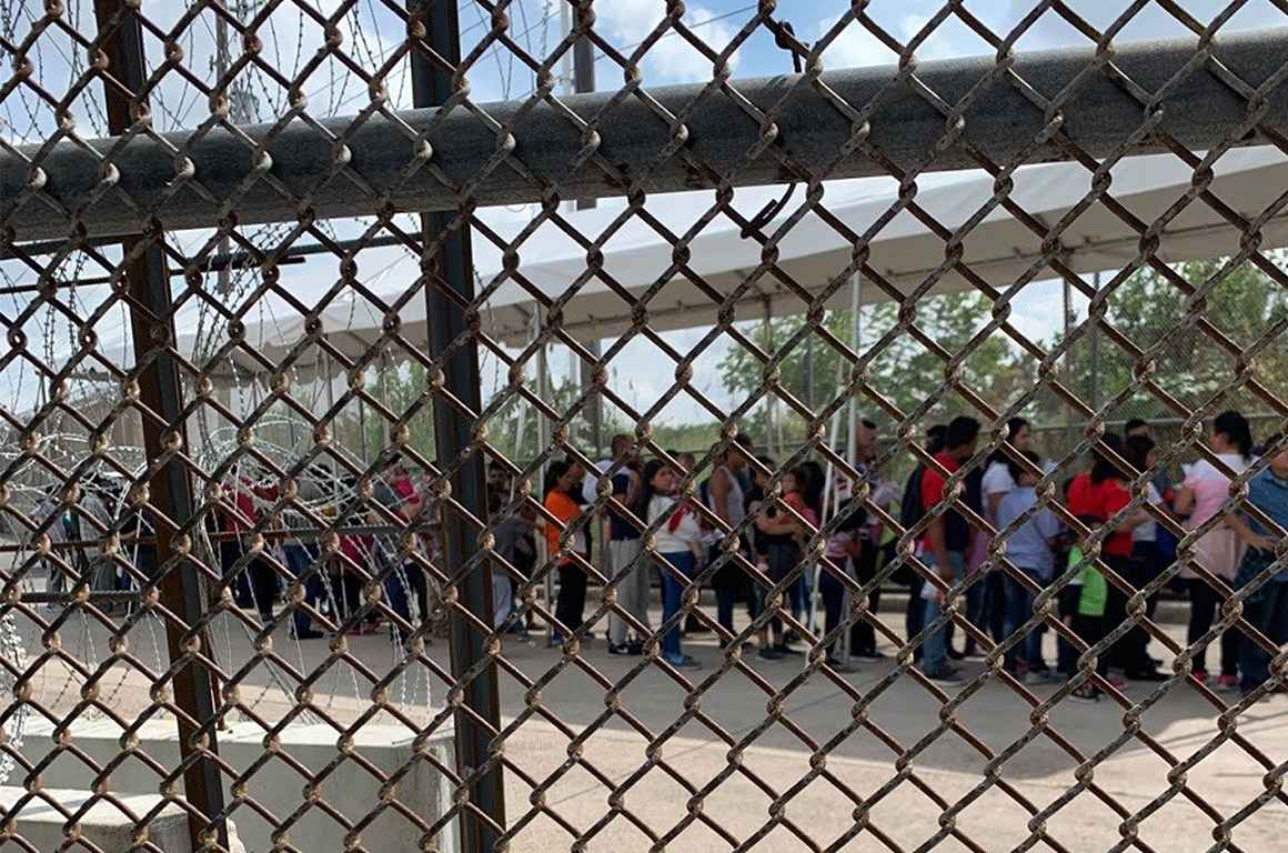 Families at the border through fence