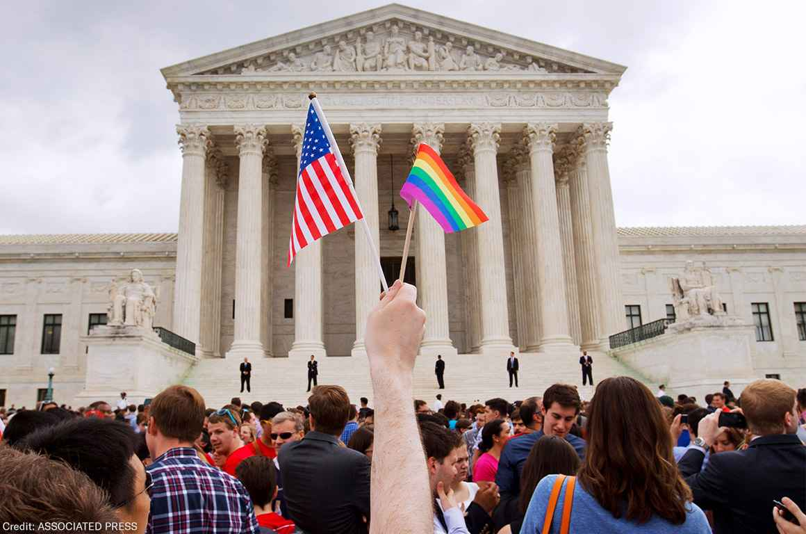 A crowd celebrates outside of the Supreme Court in Washington after the court declared that same-sex couples have a right to marry anywhere in the U.S.