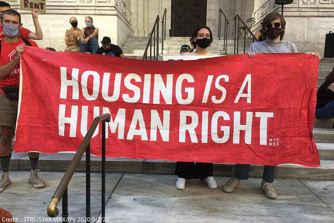 Protestors hold aloft a saying HOUSING IS A HUMAN RIGHT at a protest in New York City, September 2, 2020