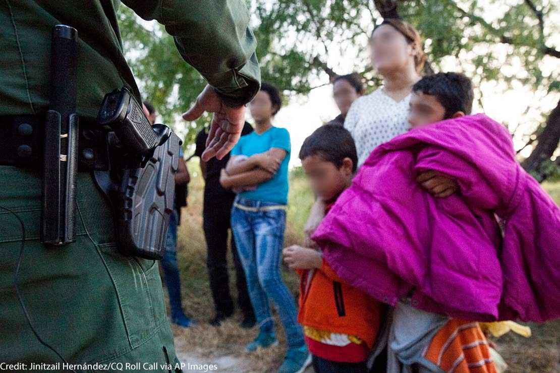 A Customs and Border Protection officer questions immigrants in Rio Grande Valley sector of the Texas border on Aug. 20, 2019.