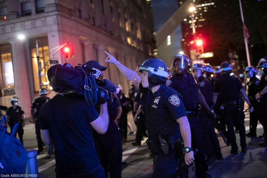 A police officer shouts at Associated Press videojournalist Robert Bumsted, Tuesday, June 2, 2020, in New York.