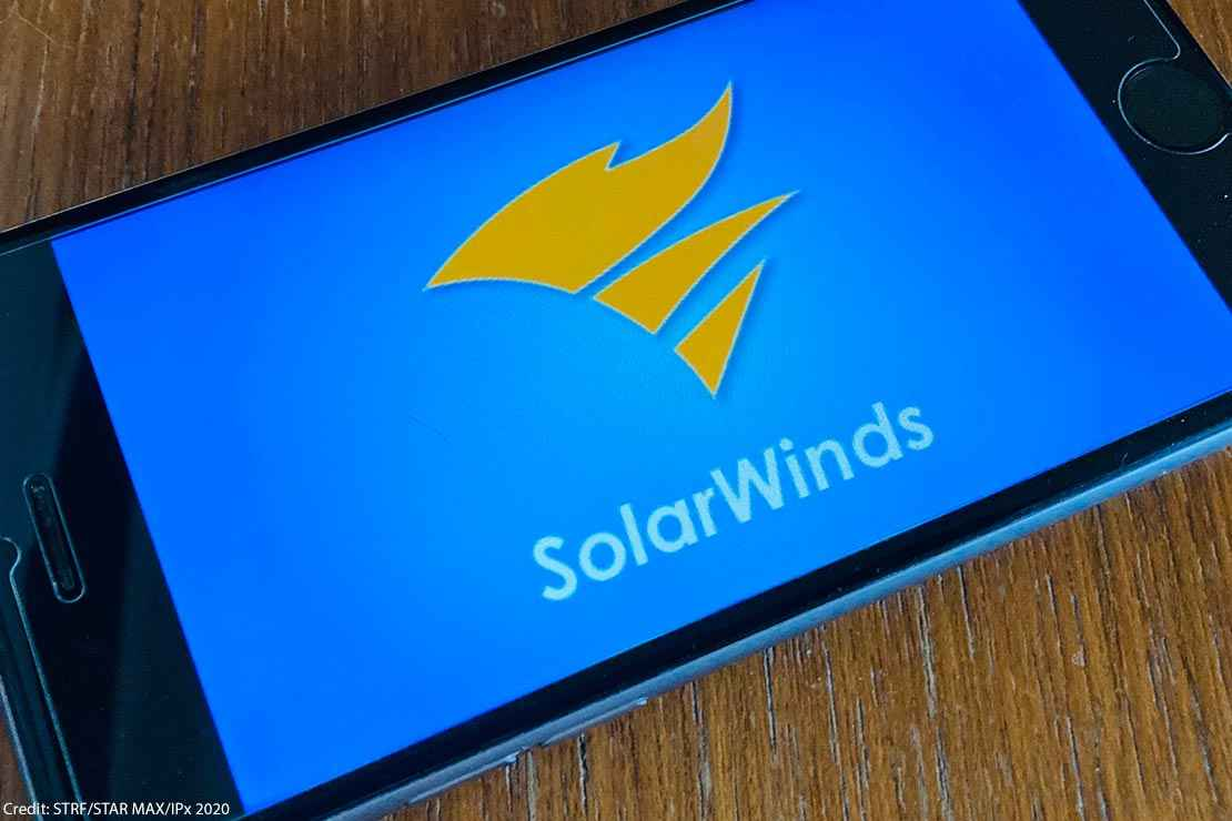 The logo of SolarWinds is seen on a phone screen